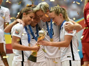 VANCOUVER, BC - JULY 05:  Alex Morgan #13, Lauren Holiday #12, Abby Wambach #20 and Whitney Engen #6 of the United States of America hold the World Cup Trophy after their 5-2 win over Japan in the FIFA Women's World Cup Canada 2015 Final at BC Place Stadium on July 5, 2015 in Vancouver, Canada.  (Photo by Rich Lam/Getty Images)