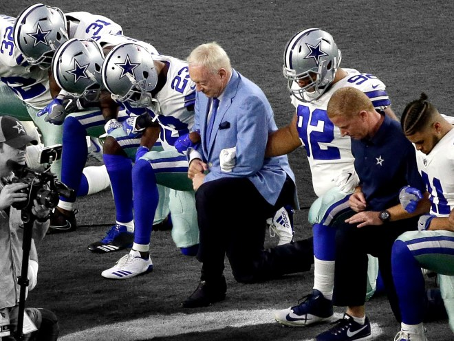 cowboys jones kneel.jpg